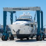 A yacht being lifted at the Bridgeport Boatworks site