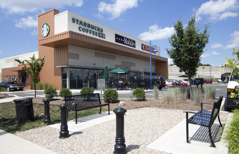 The triangle at the Steelpointe peninsula housing Starbucks, T-Mobile, and Chipotle